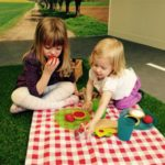 Practicing sharing during a picnic at Tots Town