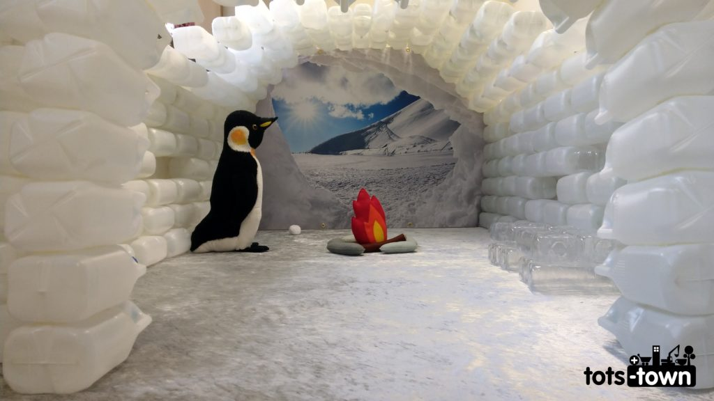 Milk jug igloo with a penguin, fire and glacier view